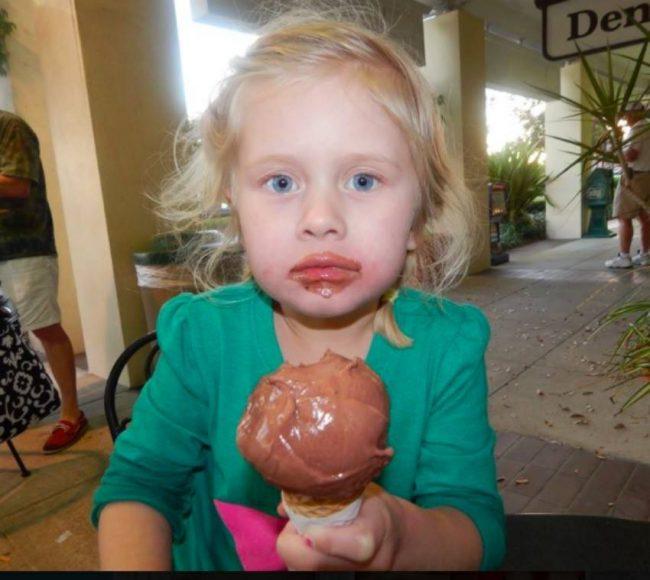 child eating chocoate ice cream
